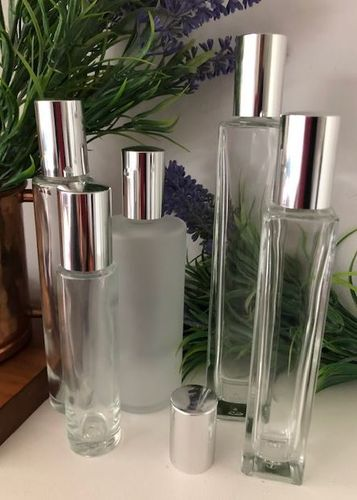Bath oil bottles with silver screw lids
